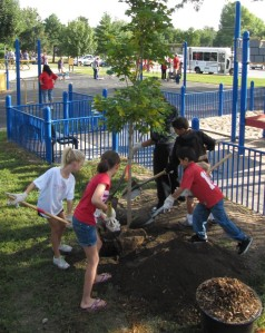 Photo of Youth Planting a Tree in Lincoln, NE. (courtesy ReTree NE)